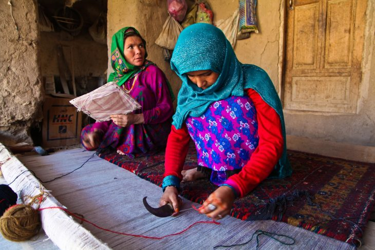 Women carpet weaving